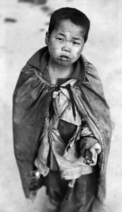 Korean War A young Korean boy begging for food, Pusan, Korea, 1953.