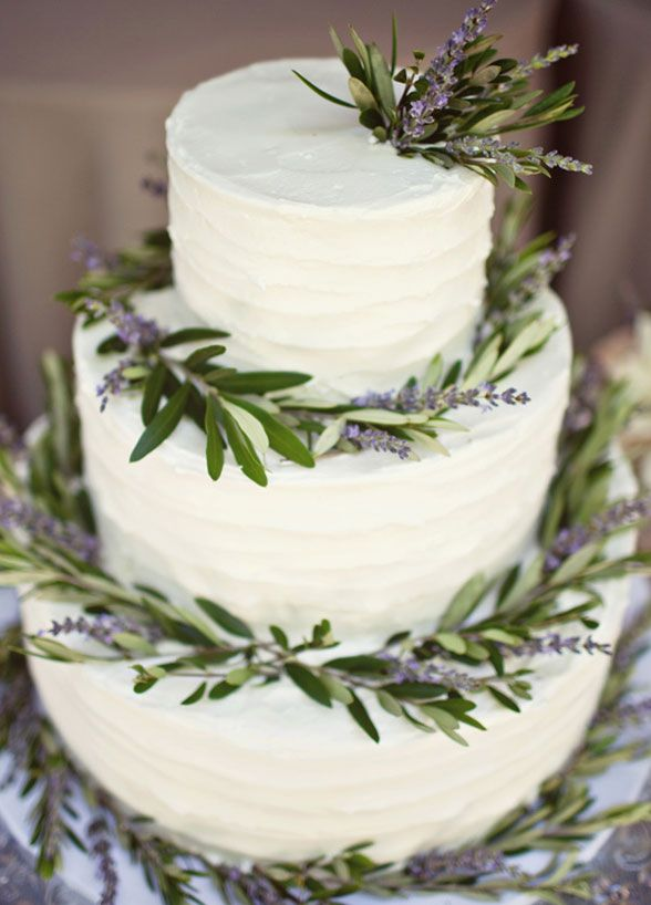 Fresh and fun, an all white three-tiered cake lined with lavender is just the thing for the rustic bride.