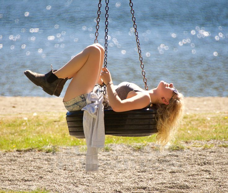 Curly blonde swinging in the sunshine