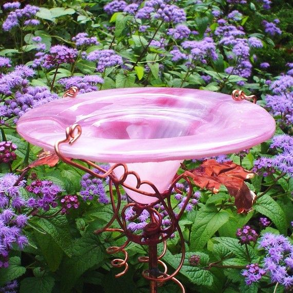 garden butterfly feeder!!! Fill with ripe fruit & it attracts butterflies :)