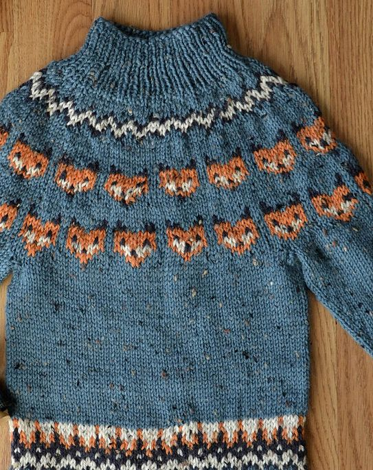 Free Knitting Pattern for Fox Sweater - Pullover sweater with fox head motifs in stranded colorwork. Designed by Amy Gunderson for Universal Yarn. Sizes 1-2 (2-4, 4-6, 6-8, 8-10) year