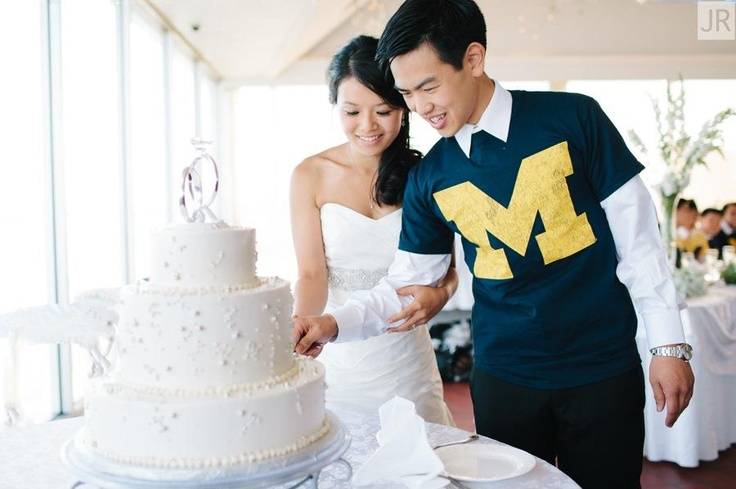 Cutting the cake, Wolverine style #wedding #roostertail #cake #umich
