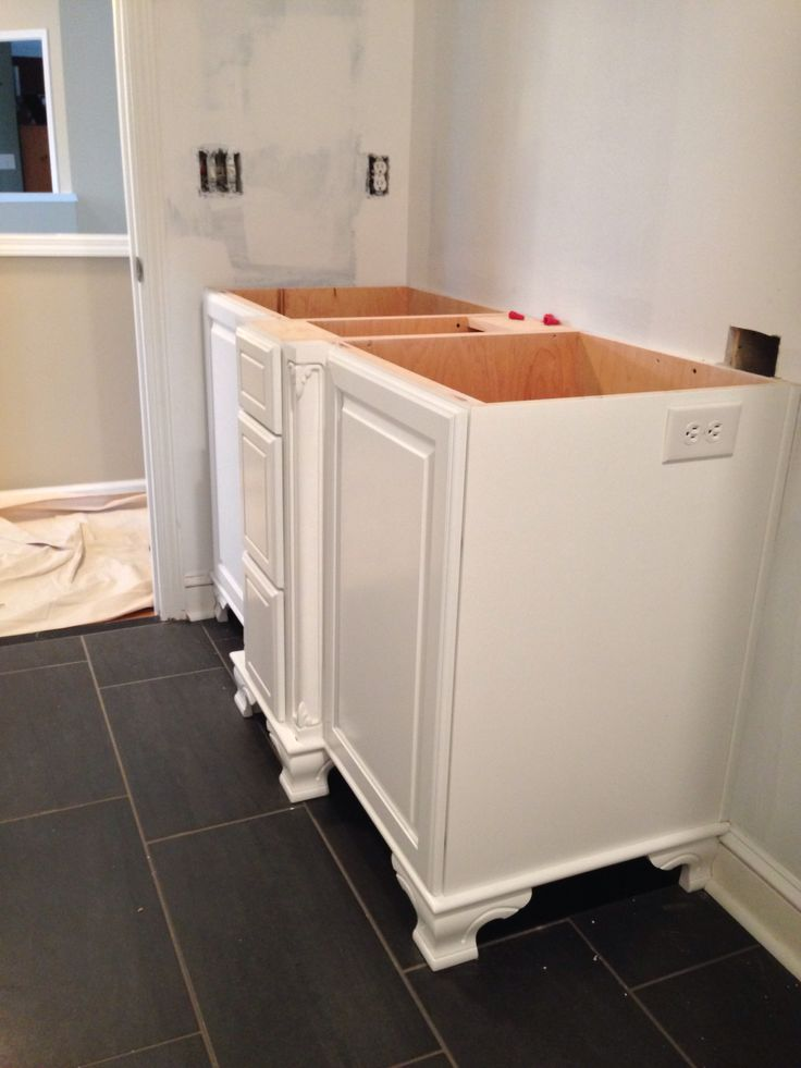 Custom cabinet and new tile floor baseboard and shoemold for Bathroom cabinets greenville sc
