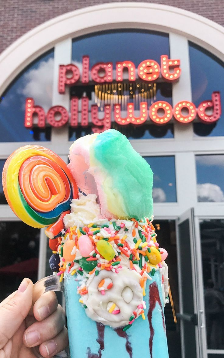 The ultimate milkshake with cotton candy, lollipops, and sprinkles at Planet Hollywood! Planning a trip to Orlando? I've rounded up the top 10 things to do in Orlando, Florida, that are guaranteed to make your trip a success. Whether you're moving to Orlando or just headed in on vacation, you will LOVE this list of fun activities in Orlando by Florida travel blogger Ashley Brooke Nicholas #CORTatHome sponsored by @cortfurniture | affordable travel tips, orlando vacation tips, vacation tips…
