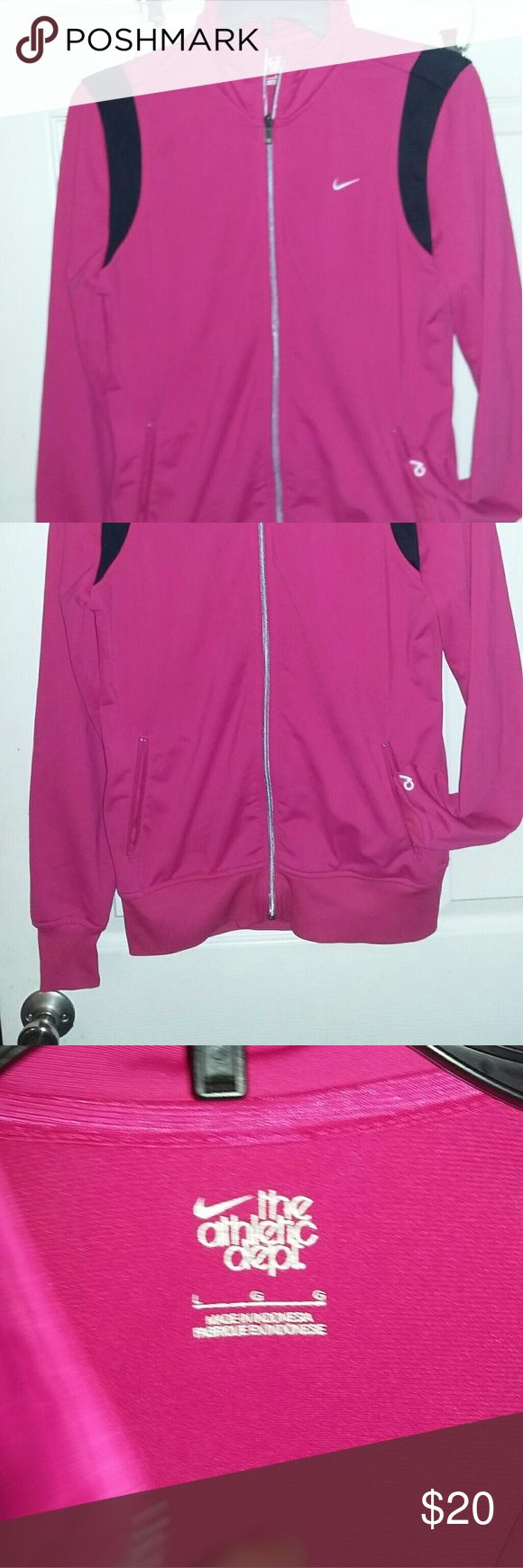 Nike zip up jacket pink and black large Womens pink and black Nike zip up jacket in good condition. Size is large but fits more like a medium Nike Jackets & Coats