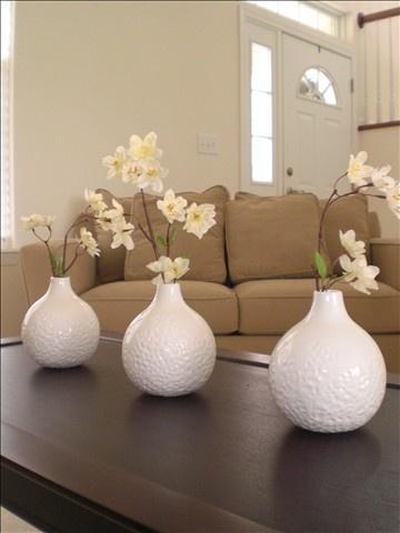 Spring Decor. spray paint all my black mini vases white.