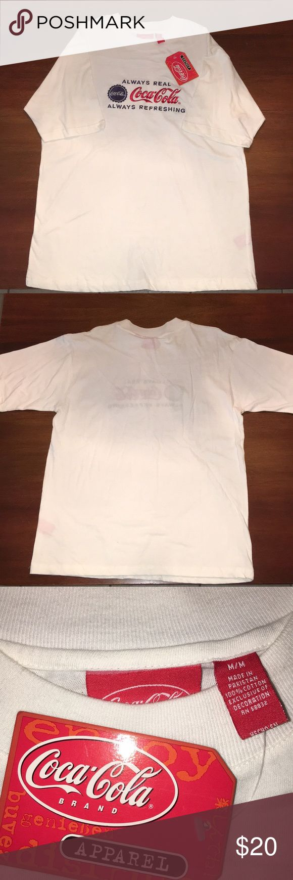 WHITE COCA COLA T-SHIRT This is a very cool Coca Cola T-shirt brand new with the tag still on it, I was gifted this shirt but I don't drink soda so I had no reason to wear it.   🤔CONDITION - EXCELLENT   🧐FLAWS - LITTLE TO NONE  🤓BRAND - COCA COLA   🛑DON'T LIKE THE PRICE ? SHOOT ME AN OFFER🛑   ⚠️Poshmark takes a cut out of every sale, no low balling on offers please⚠️ Coca Cola Shirts Tees - Long Sleeve