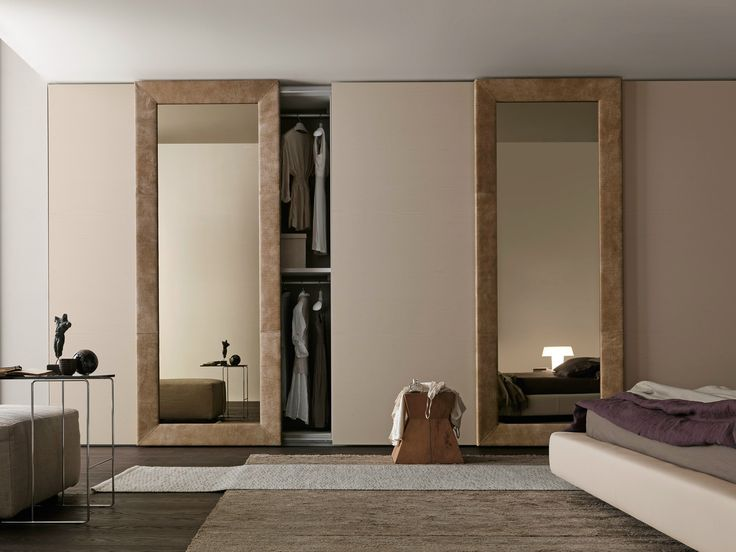 """Wardrobe with Liscia sliding doors in corda color wood and Mirror door with bronze mirror, frame faced with """"aged"""" camel leather."""