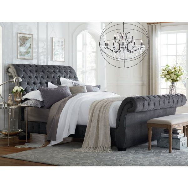 This upholstered sleigh bed from the Bombay Collection is made in a stylish gunmetal fabric. #Decor #Home