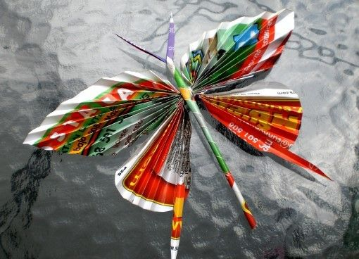 Free Tutorial: Recycled Paper Butterflies. Very Pretty Use For Junk Mail, Old Magazines Or Wrapping Paper! From www.allfreeholidaycrafts.com