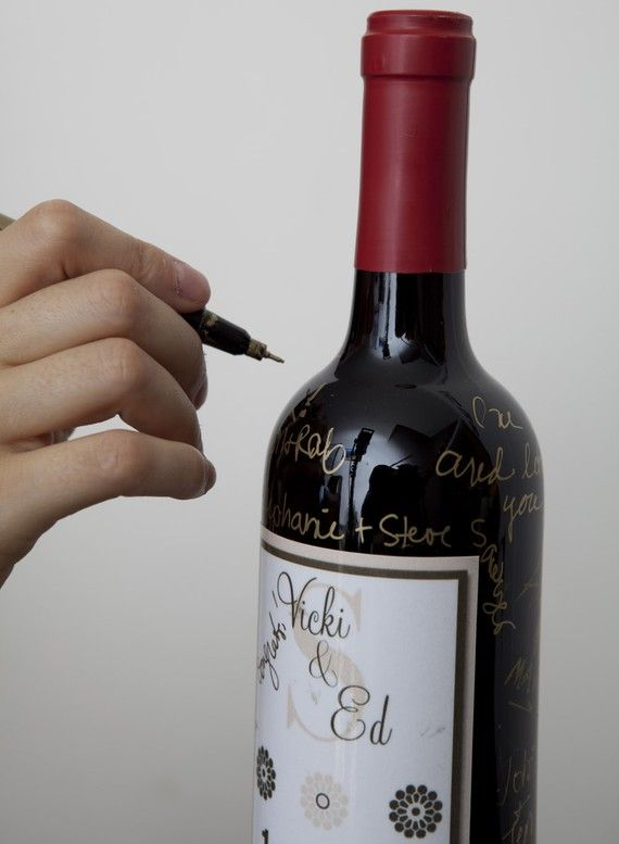 Wine bottle guestbook. Because we all know 98% of my eventual wedding will involve drinking.