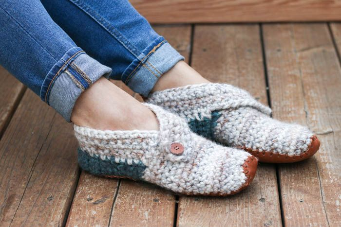 """This free crochet slippers pattern will satisfy the modern minimalist in you while also making you feel like a gift giving hero. They make the perfect gift for teachers, new moms, a friend who is sick and anyone else you want to wrap up in a little bit of love. Free women's slipper pattern from MakeAndDoCrew.com using Lion Brand Wool Ease Thick and Quick in """"Fossil"""" and """"Blueberry."""""""