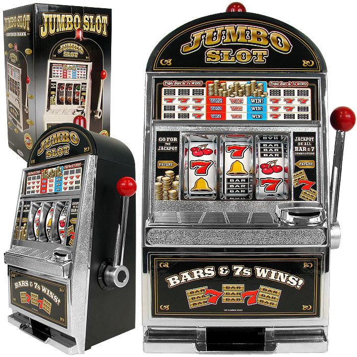 """Features:  -Slot machine bank.  -Requires 2 """"AA"""" batteries for light and bell- not included.  Plays Sound: -Yes.  Pull Lever: -Yes.  Game Type: -Slot Machine. Dimensions:  Overall Height - Top to Bott"""