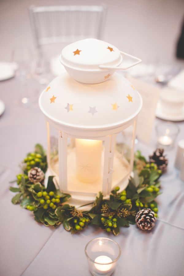 winter wedding centerpiece, photo by 3Photography http://ruffledblog.com/toronto-winter-wedding #centerpieces #wedding #lantern