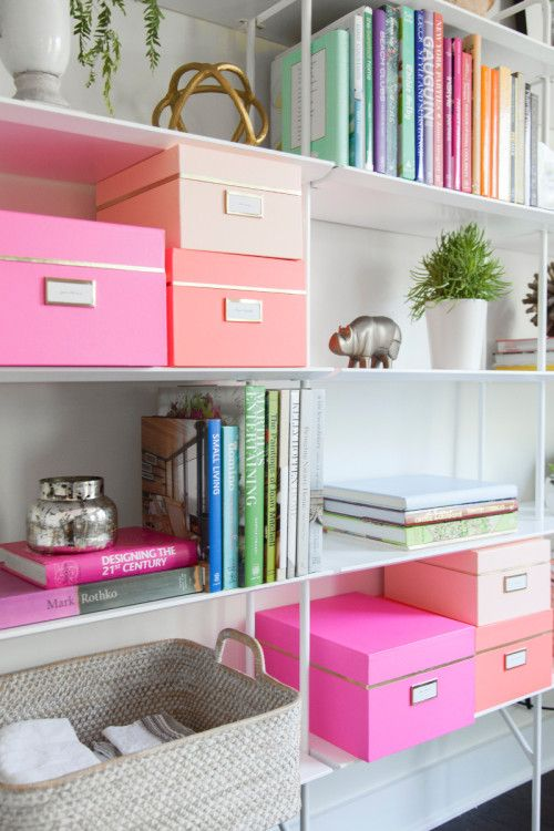 Colorful boxes to organize shelves.