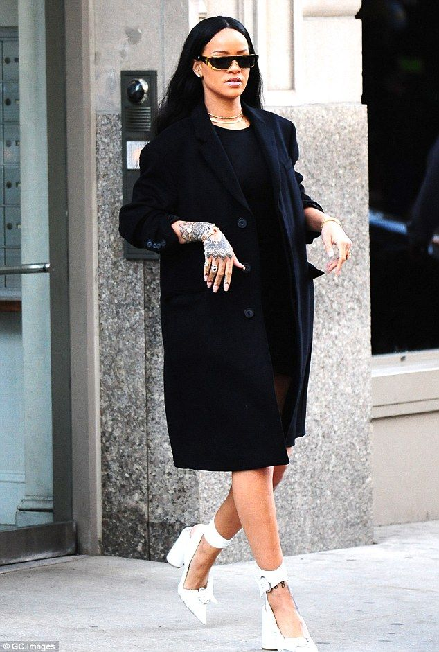 Strutting her stuff: Rihanna looked high-fashion chic when she stepped out of her apartment in New York on Wednesday