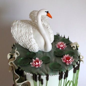 'Swan Lake' cake for Stella's 80th birthday - carrot, chocolate and cherry cakes filled and coated with ganache, all fondant iced with handmade and dusted flowers, hand painted banners, piped details and cherry cake-filled swan
