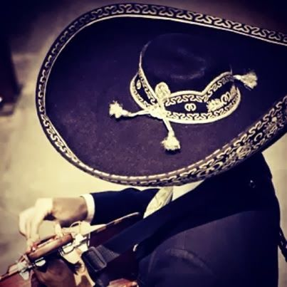 This picture reminds me of my father!!! We burried him wearing his black mariachi suit n i kept the hat . Oh how i miss him.