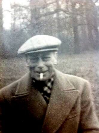 H.M. King George VI enjoying a cigarette. This rare private photo was probably taken c. Late 1951-1952. He would die very soon afterwards of lung cancer.