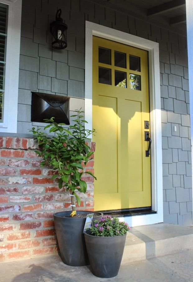 Yellow door with a grey house. Black door knobs also. Beautiful Front Door Paint Colors - Satori Design for Living