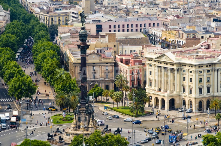 Barcelona with tree-lined Las Ramblas Avenue and statue of Colon. Copyright: National Geographic / Annie Griffiths