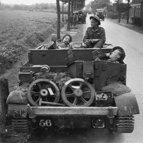 British soldiers taking a rest in a Bren Gun Carrier during a lull in Operation Market Garden