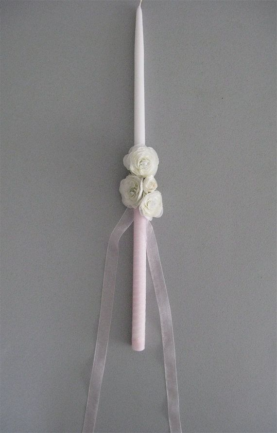 Simple Wedding Candle, maybe with a bowed ivory ribbon? And only one or two flowers