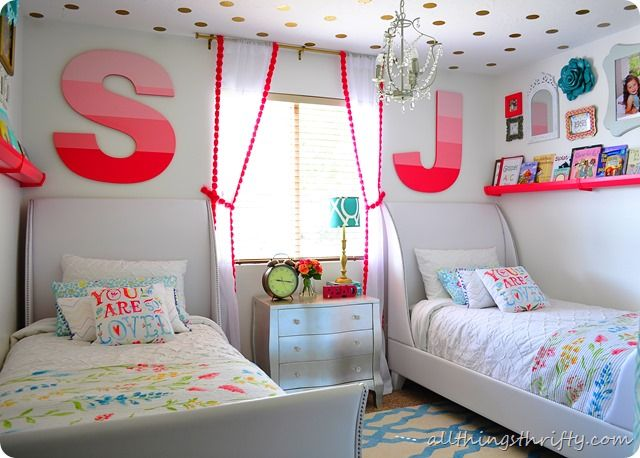 I love the white beds in this girl's room! Click for the source.
