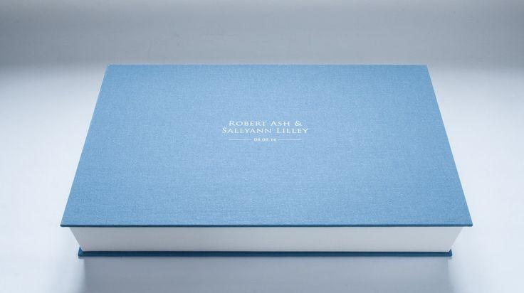 A custom clamshell archive box for a wedding album.