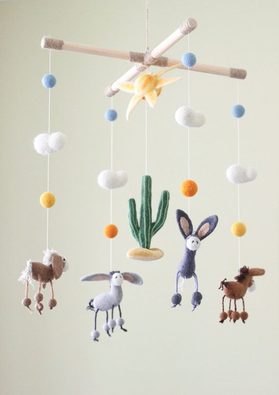 Donkey Baby Mobile, Needle Felted Baby Mobile, Cactus Nursery Decor, Baby Shower Gift, Western Baby Crib Mobile  This cute baby mobile will be a lovely mobile for your baby and become a perfect decoration for the nursery.  This listing includes wood frame, 4 needle felted donkeys, one big sun, cactus, clouds and little balls. The needle felted details are made with 100% merino wool.  MOBILE SIZE Wood frame - 11,8 x 11,8 inches ( 30x30 cm) The total high of the mobile, from the wood frame to…