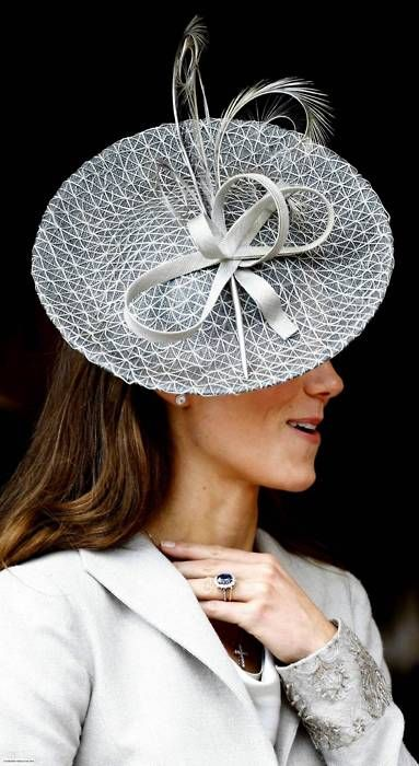 Kate looks lovely but I'm glad I don't have to wear those little hats on the side of my hair.