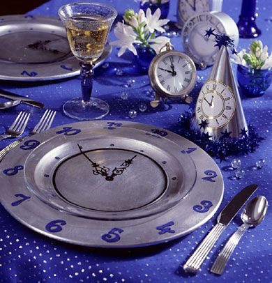 Decorate your table with a time theme for your New Year's Eve party! More decor ideas: http://www.bhg.com/holidays/new-years/crafts/new-years-crafts/?socsrc=bhgpin122913newyearsdayplacesetting&page=9