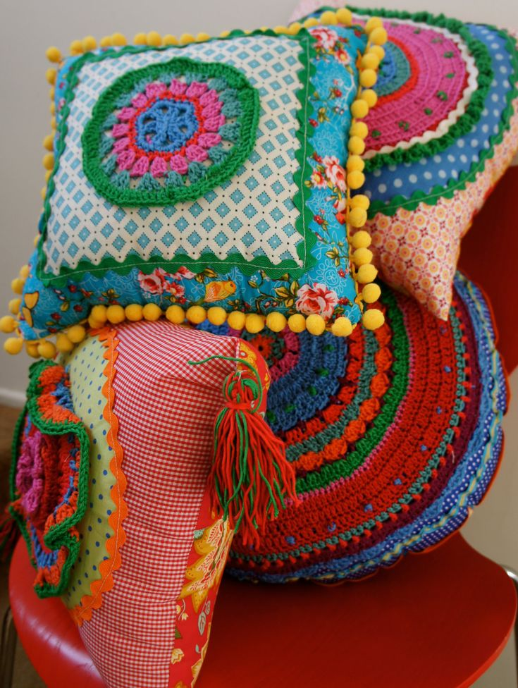 colourful cloth and crochet cushions. via Etsy. Pinspiration.