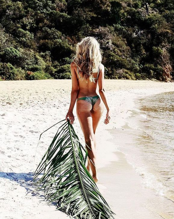 Bikini girl Natalie Roser owning the island