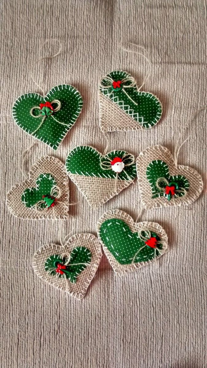handmade Christmas ornaments ... hearts made of burlap in natural and bright green ... blanket stitch edges ...
