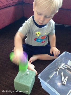 13 mos+ hammering golf tees in a styrofoam block using plastic hammer. Use fine motor skills to remove golf tees