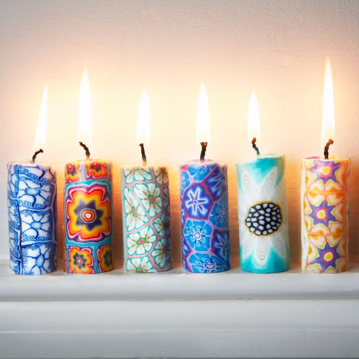 Mini Dinner Candles - Purple Leaves - Traidcraft - This set of 6 mini candles feature Swazi inspired floral designs to bring a hint of ethnicity to your home this Spring. #Handmade #FairTrade