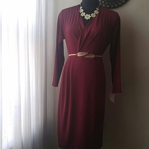 Nwt dazzling stretchy figure flattering dress New never worn..Gorgeous drape, figure flattering. Lovely wine color. 41inches in length. Belt is also available for.sale Romans Dresses Midi