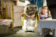 Little girl with Mrs Tiggy-Winkle at The World of Beatrix Potter Attraction in the Lake District, Bowness-on-Windermere, Cumbria, England.