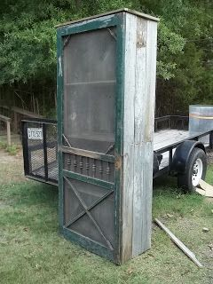 Free standing pantry from reclaimed barn wood and a screen door