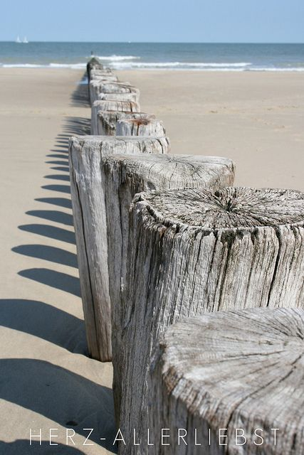 I would walk along the tops of these wooden posts. Life is a balancing act, and what better place to renew your balance than on a beach at the seaside.-MRG