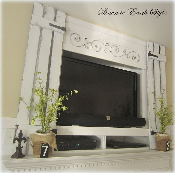 Creative fix for a TV above the fireplace: Down to Earth Style