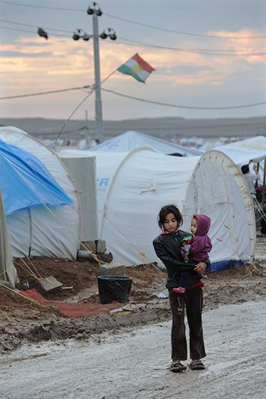 A Syrian girl holds a younger child in a refugee camp in northern Iraq. Some 2 million Syrian children are in need of assistance. Photo: Peter Biro/IRC...I remember when Syria took in the Iraq refugees, now the tables are turned. When is this going to STOP!!!>>>8/2013