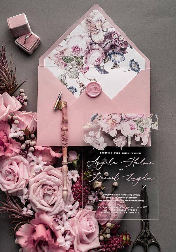 These gorgeous floral inspired wedding invitations are beautiful. These would be perfect for a spring wedding or pink floral wedding.   #pinkwedding #floralwedding #weddingdecor #weddinginvites #weddinginvitations #invitations #stationary #weddingstationary #pinkweddingflowers #weddingdecorations