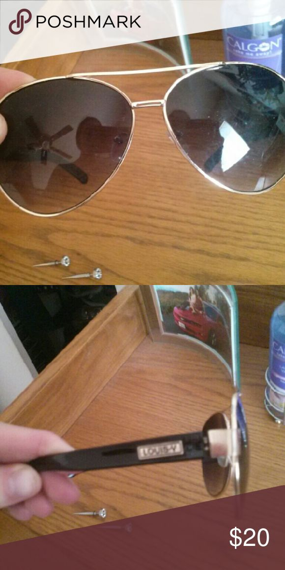 Sunglasses Fake Louis Voitton Used glasses. Has some scratches on the lens. They are used and are on the bigger side. I would say its more for a mans large head. Accessories Sunglasses