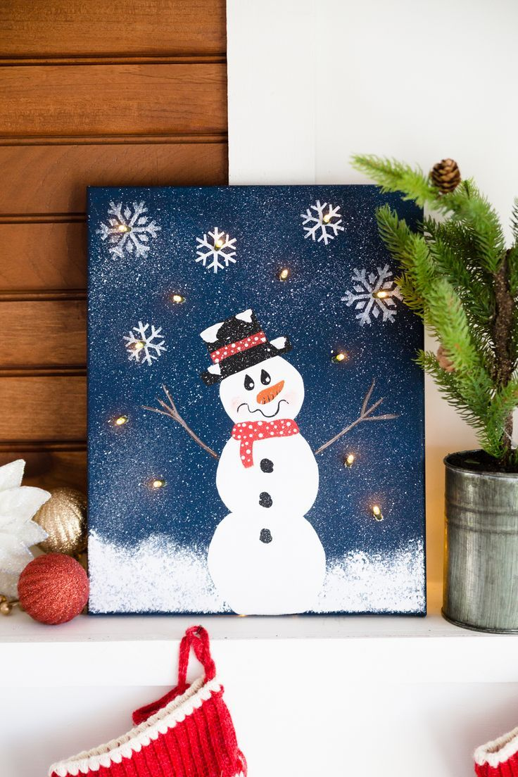 This DIY Lighted Snowman Canvas is the