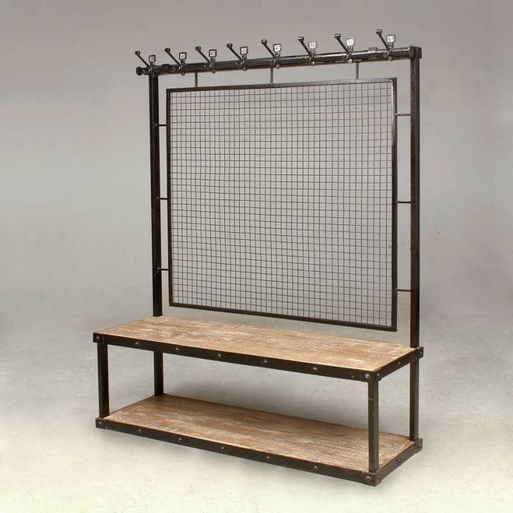 A steel framed unit painted black.Wooden bench and under shelf.Eight cast iron hooks with random steel numbers, featuring a wire mesh back.