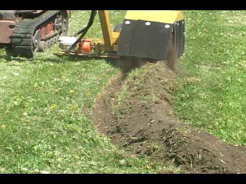 Bed Edger cutting a landscape edging trench. I've always dug mine by hand using a mattock.
