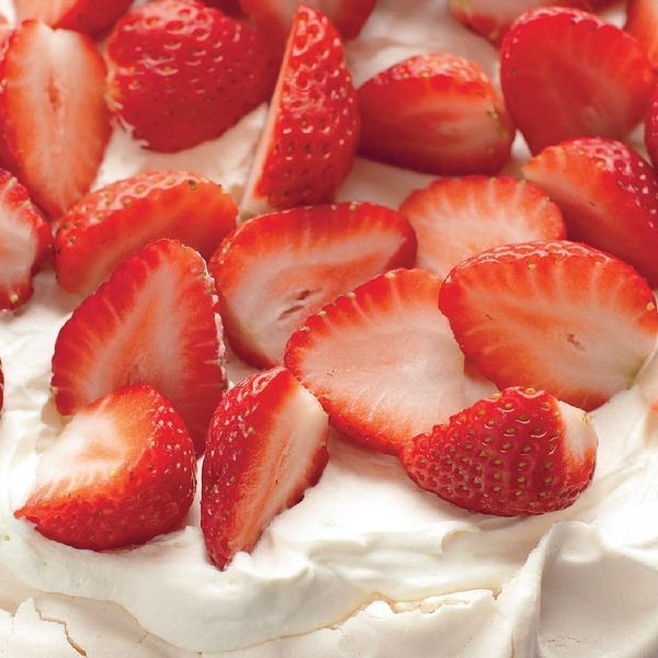 A beautifully presented strawberry pavlova from Mary Berry. With a crispy outer and soft centre, the pavlova recipe is finished with strawberries and cream.