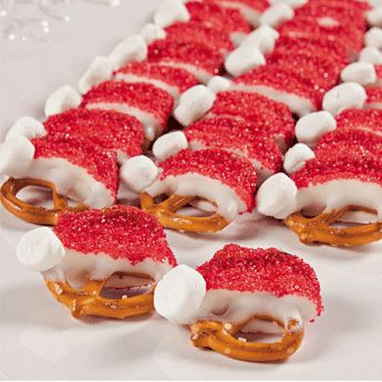 Santa Hat Pretzels- dip 1/2 of twisted pretzel in white choc and dip in red sanding sugar. Use mini marshmallow for ball. Christmas time!  FOR MELISSA R :)